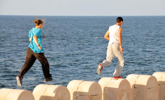 People running on a wall in Alexandria